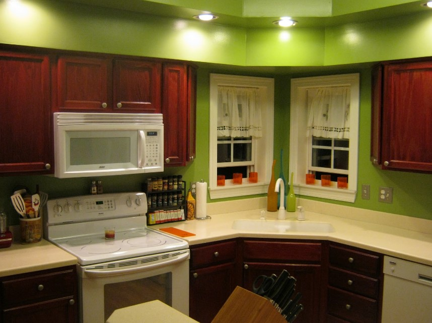 Green Color Wall With Cherry Cabinet