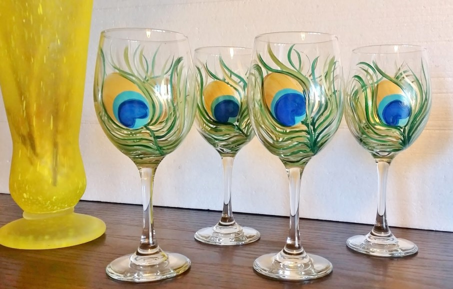 Wine glass with peacock feather
