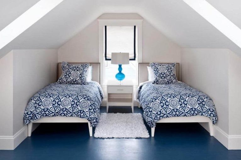 Attic bedroom with two beds