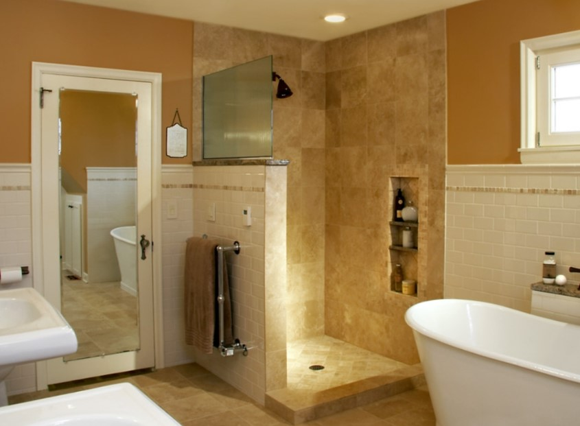 Doorless shower tiled in brown