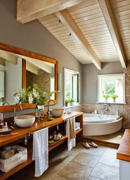 Farmhouse bathroom with stone wall