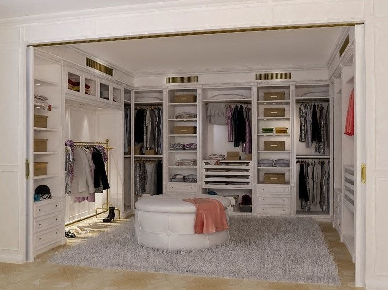 Nice walk in closet with round seat
