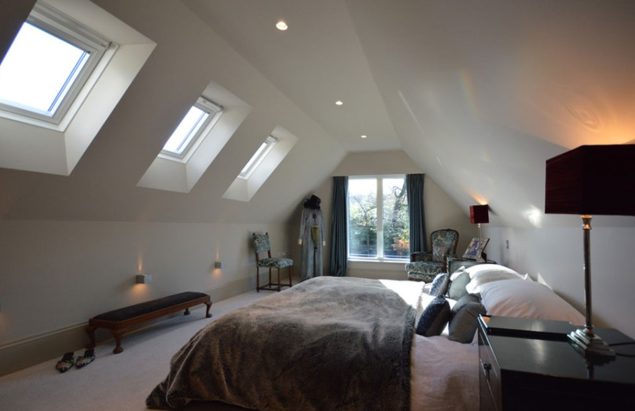 Spacious attic bedroom with some windows