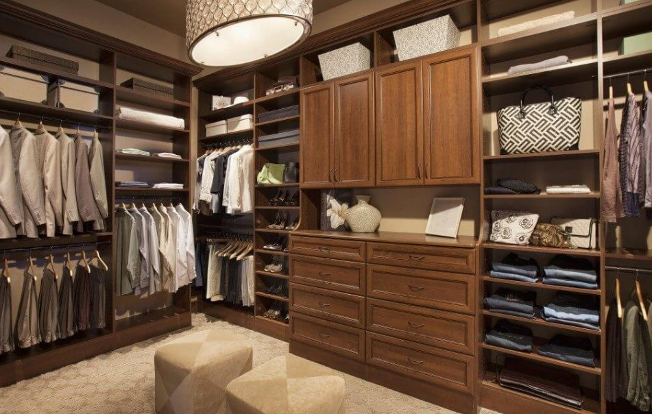 The wooden walk in closet with chairs