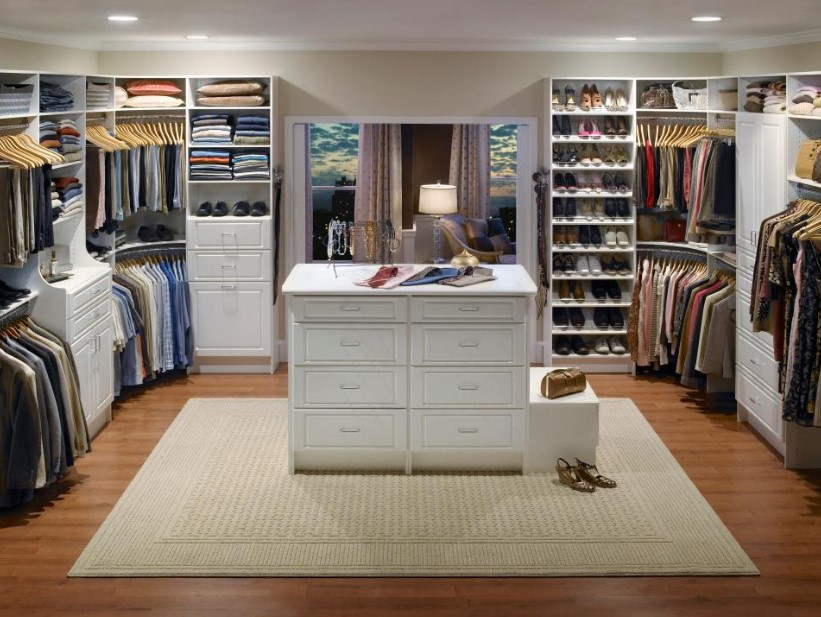 Wooden-floor walk in closet with island